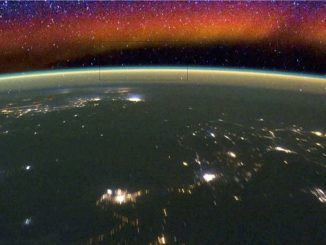 The different layers of Earth's airglow can be seen from the International Space Station as it orbits Earth. The very thin green layer above the bottom of the window occurs 95 kilometers (59 miles) above Earth's surface; the red region above is a different type of airglow. The rectangle represents the portion of the airglow measured in a single WINDII image. (NASA)