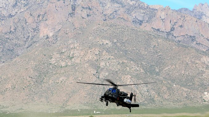 Raytheon and the US Army Apache Program Management Office, in collaboration with US Special Operations Command, recently completed a successful flight test of a high energy laser system onboard an Apache AH-64 at White Sands Missile Range, New Mexico. The demonstration marks the first time that a fully integrated laser system successfully engaged and fired on a target from a rotary-wing aircraft over a wide variety of flight regimes, altitudes and air speeds. Photo: US Army, PRNewsfoto/Raytheon Company.