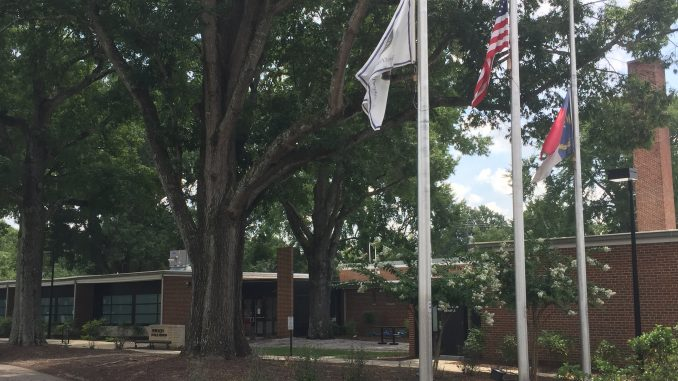 Zebulon NC Municipal Complex flags flying at half staff. Photo: Kay Whatley, 2017