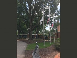 Flags at half staff. Photo: Kay Whatley