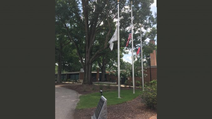 Zebulon NC Municipal Complex flags flying at half staff on July 12, 2017.