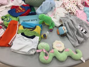 Infants' clothing and toys table at Knightdale giveaway. Photo: Kay Whatley