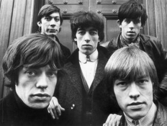 Photo by celebrity photographer Terry O'Neill available from ArtStar via www.Barnebys.com. The Rolling Stones outside St. George's Church in Hanover Square, London, January 17, 1964. Clockwise from bottom left: Mick Jagger, Charlie Watts, Bill Wyman, Keith Richards and Brian Jones (1942 - 1969). Source: PRNewsfoto/Barnebys.com