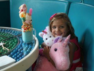 6 year old Imaginormous Winner, Giselle Decker, enjoying her unicorns at Dylan's Candy Bar. Source: PRNewsfoto/Roald Dahl Literary Estate.