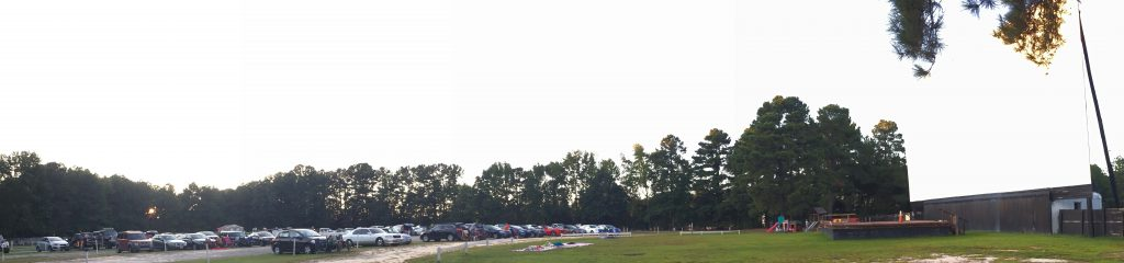 This panorama photo shows the screen and front part of Raleigh Road Outdoor Theatre. Beyond the concession stand, more rows of cars were parked. It's a big place. Photo: Kay Whatley