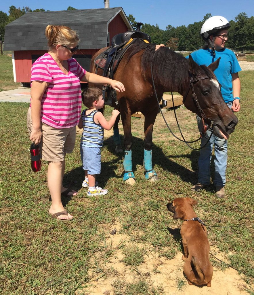 People, pup, horse Athena, and rider Haley, following their Obstacle Course run. Photo: Kay Whatley