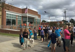 National Pumpkin Festival 2017 crowd, including pup, in front of the town hall, Spring Hope NC. Photo: Kay Whatley
