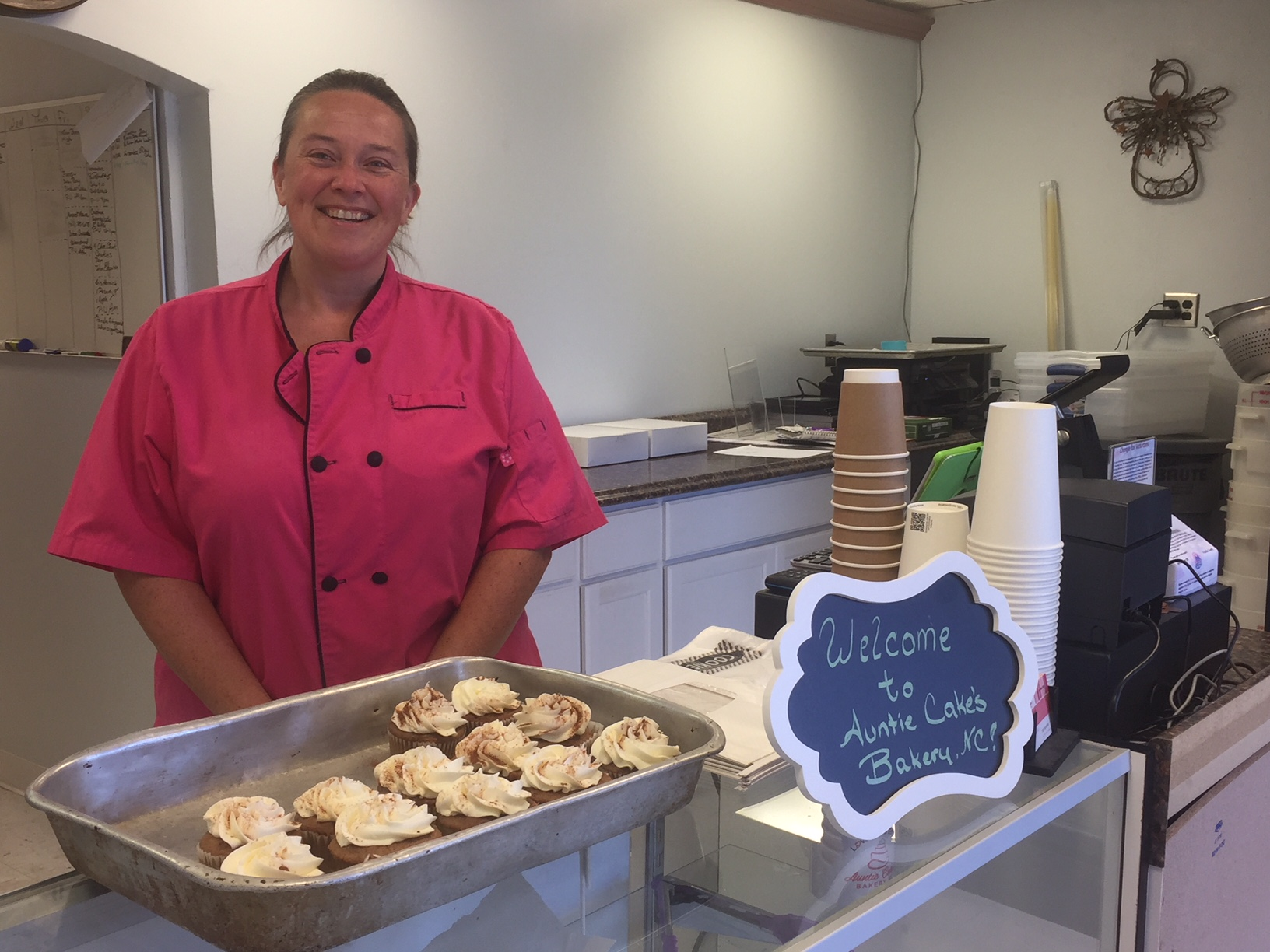 Baker Katharine Colclough with her apple spice cupcakes in Auntie Cake's Bakery, NC. Photo: Kay Whatley