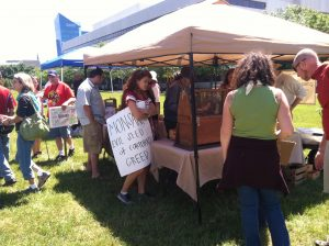 Vendors set up before March Against Monsanto on May 25, 2013 in Raleigh NC. Photo: Kay Whatley