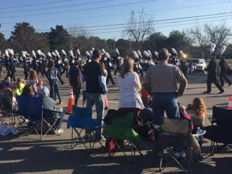 Marching band passing the crowd at the 2017 Christmas Parade in Zebulon NC. Photo: Kay Whatley