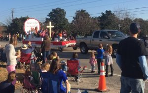 Float passing the crowd at the 2017 Christmas Parade in Zebulon NC. Photo: Kay Whatley