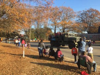 Army vehicles driving up Gannon Avenue in the 2017 Christmas Parade in Zebulon NC. Photo: Kay Whatley