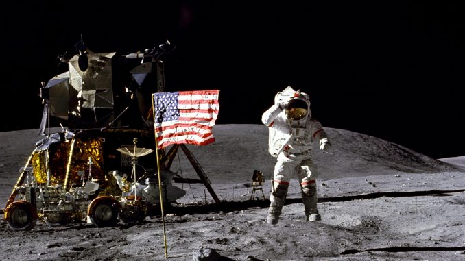 John Young on the Moon, with the Lunar Module and Lunar Rover in the background. Credit: NASA
