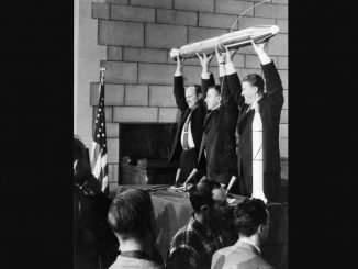 A model of Explorer 1 is held high by (left to right) JPL Director William Pickering, James Van Allen, and Wernher von Braun at a late-night news conference announcing the launch of Explorer 1, held at the National Academy of Sciences in Washington, DC. Image: NASA/JPL-Caltech