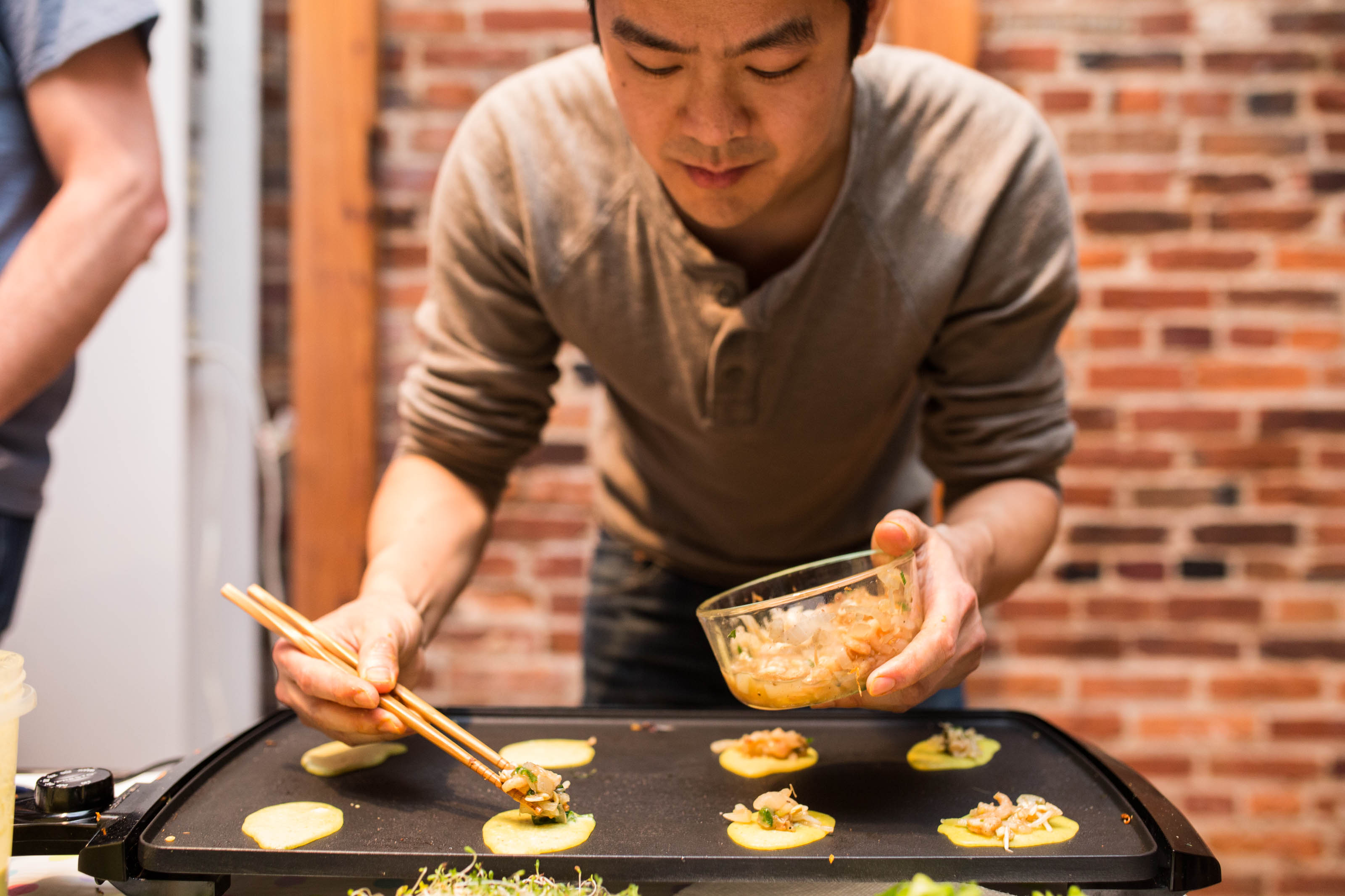 Phong Le prepares a tiny version of Banh Xeo at a 2017 Small Foods Party. Source: Small Foods Party, Baltimore MD.