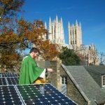 Rev. Jered Weber-Johnson blessing solar panels at St. Alban's Parish, Washington DC. Photo: Carlo La Porta