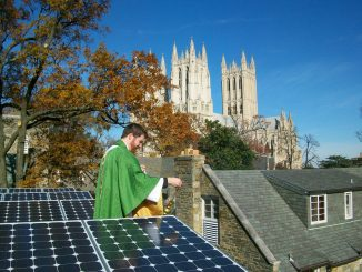 Rev. Jered Weber-Johnson blessing solar panels at St. Alban's Parish, Washington DC. Photo: Carlo La Porta