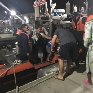 Coast Guard Station St. Petersburg, Florida, crewmembers assist rescued boaters disembark a Coast Guard 29-foot Response Boat-Small II at the station, March 4, 2018. A station St. Petersburg boatcrew rescued the seven boaters from a disabled and drifting 14-foot boat in Tampa Bay. Source: US Coast Guard