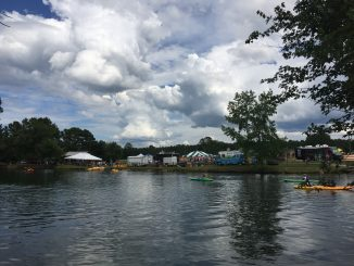 View of kayaks, vendors, and music area at the 2017 Blueberry Music Festival, Vollmer Farm, Bunn NC. Photo: Kay Whatley