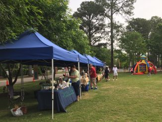 Several Zebulon Farm Fresh Market vendors and an inflatable at a May 2018 market event. Photo: Kay Whatley