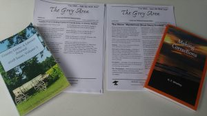 Literacy Day handouts on area writing contests, flanked by local book/journal. Source: Cindy Brookshire