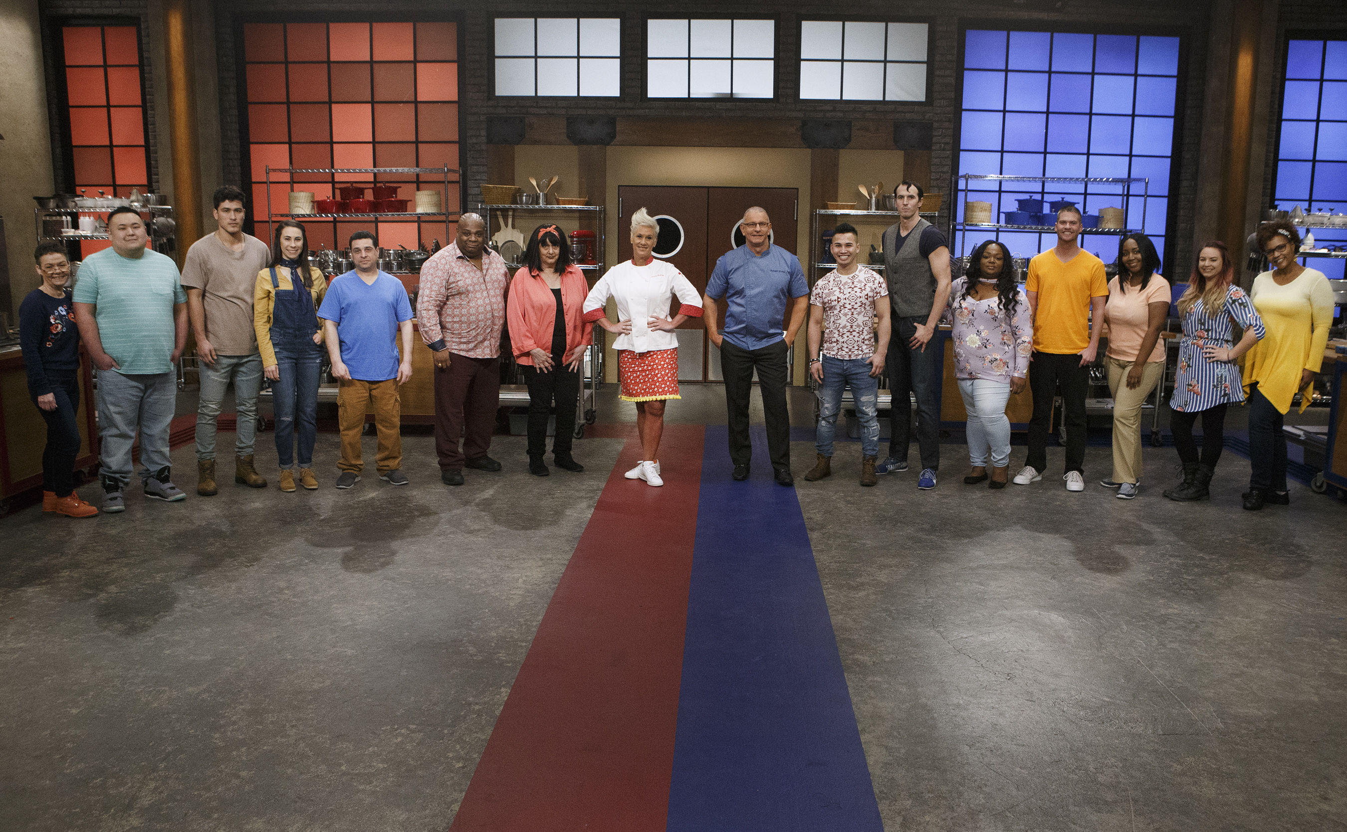 Mentors Robert Irvine and Anne Burrell pose with recruits Linda Martin, Rudy Rehberg, Bradley Garcia, Sarah Harris, Frank Scuderi, Marcus Ellis, Maryann Rapisarda, Timmy Thok, Robbie Deraffele, Janese Henry, Copan Combs, Kimberly Worthy, Jessica Paulson and Carla Waddell, as seen on Worst Cooks in America, Season 14. Source: Daniela Medina, Allied Integrated Marketing