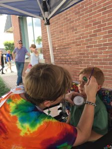 At the festival in Wendell NC, visitor Eli gets his face painted. Photo: Kay Whatley
