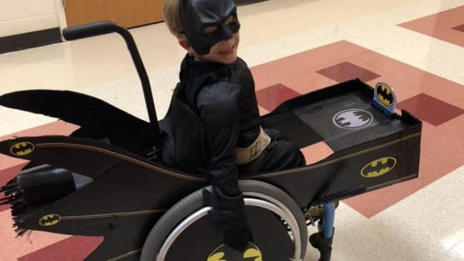 Bryson Jackson of Henderson NC in his Batmobile hot-rod wheelchair at 2018 Fall Festival. Source: Donna Wade, The Miracle League of Franklin County (NC)