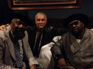 Frank Whatley, founder of The Grey Area News, with Tommy and George Clinton in February 2014.