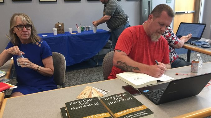 Author Steven E. Davis at a book signing in Rocky Mount NC. Photo: Kay Whatley, August 2018
