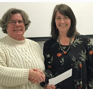 "Ellen Queen of FCAC awarded the Carolina Prize for Writing to Prose Winner Judy Reed for her ""June Magic"" short story. Source: Franklin County Arts Council"