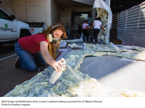 "Museum of Outdoor Arts Design and Build Intern Artist, Lauren Crawford, working on production of ""Natura Obscura"". Photo: Heather Longway. Source: Blake Communications"