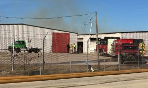 Smoke rising from the far warehouse at Montclair Complex, Bunn, NC. Photo: Kay Whatley