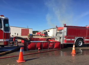 Several of the responding fire departments at the fire scene. Photo: Kay Whatley