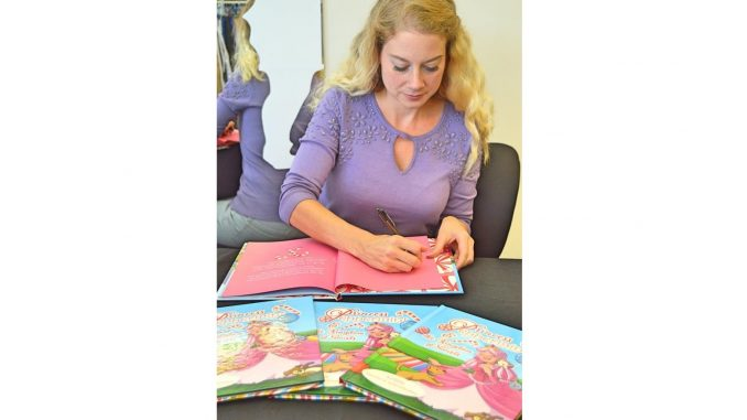 E. Claire book signing for Princess Peppermint and the Kingdom of Swirls. Source: Mascot Books