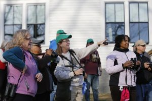 Lynn Beegle, center, of Raleigh, points out a bird for Claudia Graham, second from left, of Raleigh, before the start of the Great Backyard Bird Count at Dorothea Dix Park in Raleigh, NC, Friday, February 15, 2019. Held Friday through Monday February 18th, the 22nd annual GBBC uses volunteers, from beginning bird watchers all way to experts, to take a snapshot of global bird populations. Participants can count as short as 15 minutes and upload their findings online to help researchers. Photo: Eamon Queeney / For the National Audubon Society