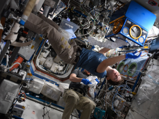Expedition 58 Flight Engineer Anne McClain conducts a science experiment aboard the International Space Station. Photo: NASA