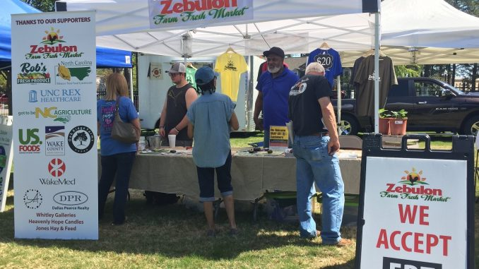 Zebulon Farm Fresh Market tent, which facilitates EBT, provides information, and more. Photo: Kay Whatley