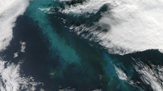A 2009 phytoplankton bloom in the Bering Sea. New research shows cloud seed bacteria may feed on phytoplankton. Credit: NASA/Jeff Schmaltz.