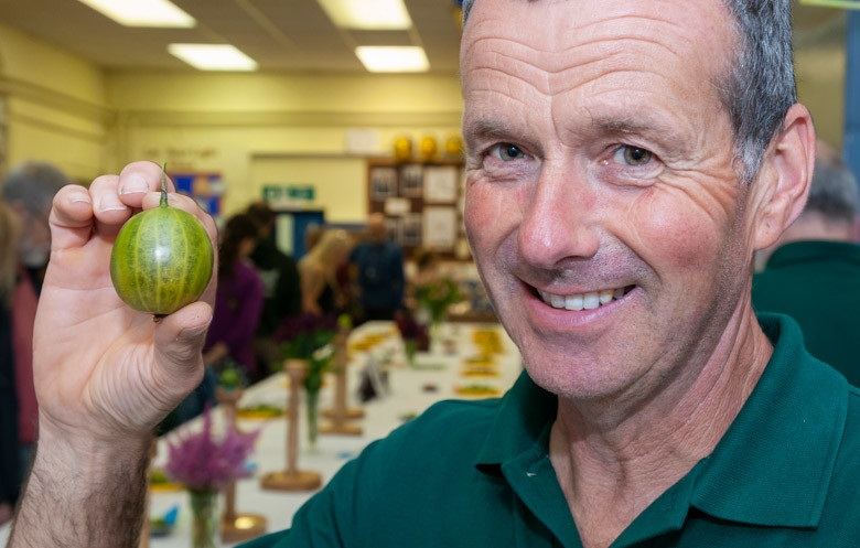 Graeme Watson with hsi 2019 Guinness World Record gooseberry. Photo: Paul Anthony Wilson