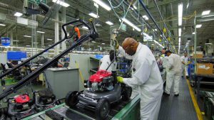 A Honda Power Equipment associate makes adjustments to a lawnmower in final assembly at the Swepsonville, NC plant. Source: Honda North America