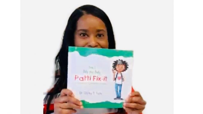 Author Dr. Tiffany D. Tyson with Book 1: Billy the Bully. Source: Tyson Multimedia Inc.