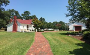 The Country Doctor Museum tour and garden are across the street from the parking, Visitor's Center, Carriage House, and event grounds. Photo: Kay Whatley