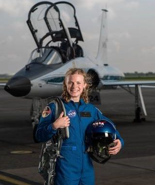 NASA portrait of 2017 Astronaut Candidate Zena Cardman in front of a T-38 trainer aircraft at Ellington Field near NASA's Johnson Space Center in Houston, Texas. Source: NASA
