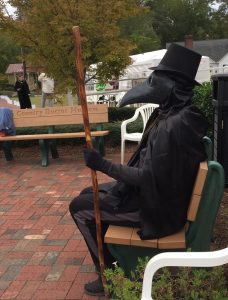 "Volunteer dressed as a Plague Doctor, playing statue and waiting for someone to sit down for a ""Boo."" Photo: Kay Whatley"