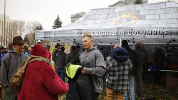 More than 400 homeless in Denver received new winter coats from Knights of Columbus Council 539 in Lincoln Memorial Park. Source: Knights of Coumbus