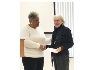 Carolina Prize Writing Contest poetry winner Alice Pettyjohn receives award from Jackie Dove-Miller. Source: FCAC Writers' Guild