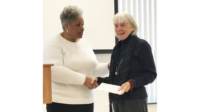 Carolina Prize Writing Contest poetry winner Alice Pettyjohn receives award from Jackie Dove-Miller in 2019. Source: FCAC Writers' Guild