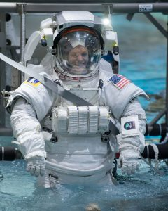 NASA astronaut candidate Zena Cardman in a spacesuit is lowered into the training pool at NASA Johnson Space Center's Neutral Buoyancy Laboratory. Photo: NASA/David DeHoyos