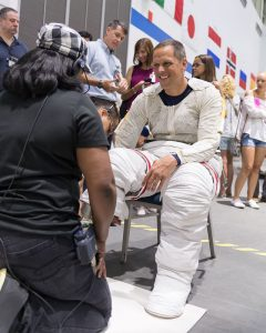 NASA astronaut candidate Bob Hines in a Liquid Cooling and Ventilation Garment and being helped into a spacesuit prior to underwater spacewalk training at NASA's Johnson Space Center Neutral Buoyancy Laboratory in Houston. Photo: NASA/Norah Moran